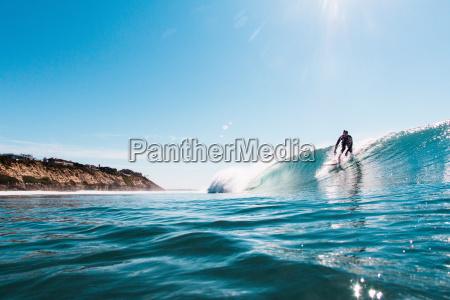 young man surfing ocean wave encinitas