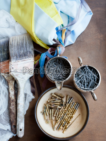 still life of decorating brushes textiles