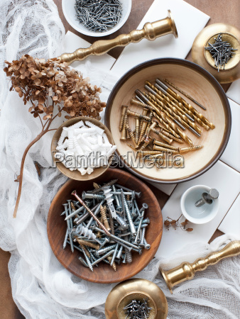 still life of screws nails and