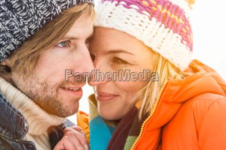 portrait of couple wearing knit hats