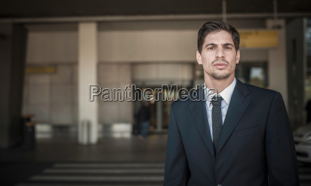 portrait of young man outside airport