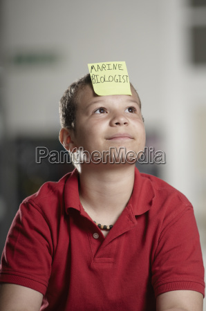 portrait of boy with sticky note