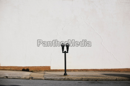 parking meter on pavement
