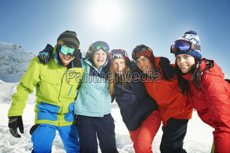 friends, wearing, skiwear, with, arms, around - 19512980