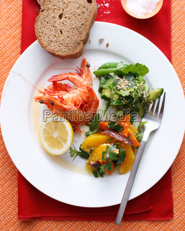 plate of prawns with salads and