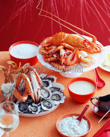 plates of lobsters prawns and mussels