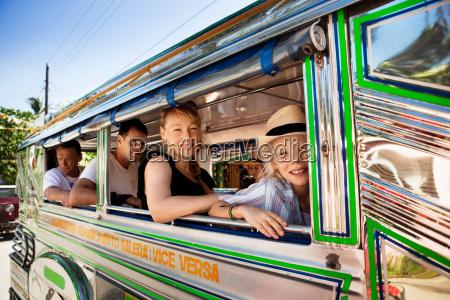 passengers sitting by bus window