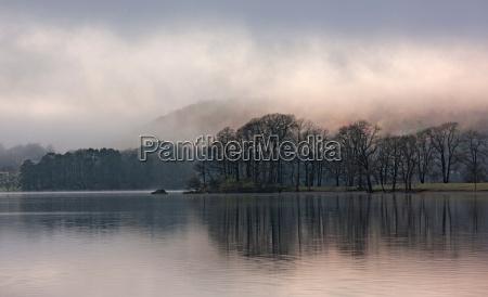 fog rolling over rural landscape