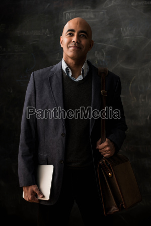businessman with satchel and digital tablet