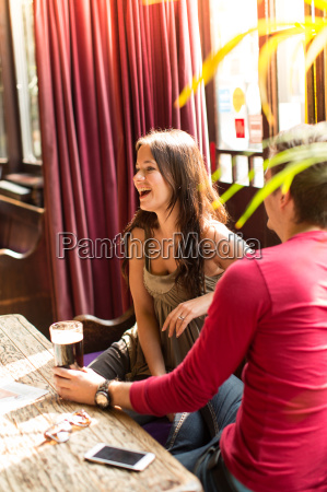 couple sitting together laughing enjoying a