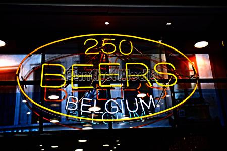 neon sign advertising belgian beer