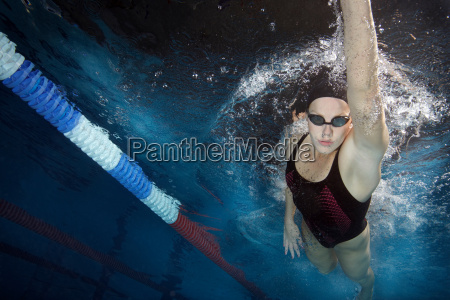 swimmer doing front crawl in pool