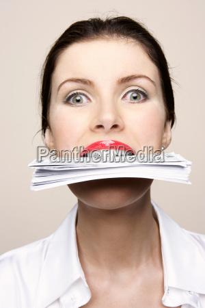 woman biting bank notes
