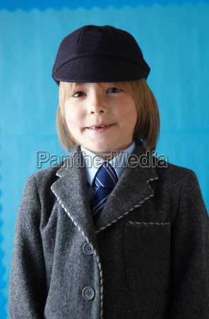 boy in school uniform smiling at