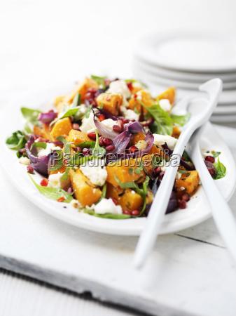 chopping board with butternut squash salad