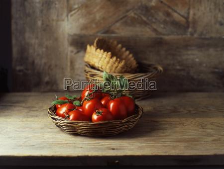 fresh organic roma tomatoes in wicker
