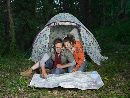 couple reading map in front of