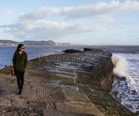 young woman strolling along the cobb