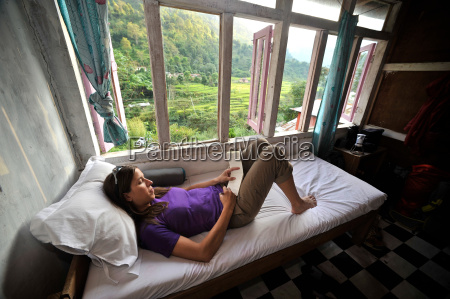 woman relaxes in her room at