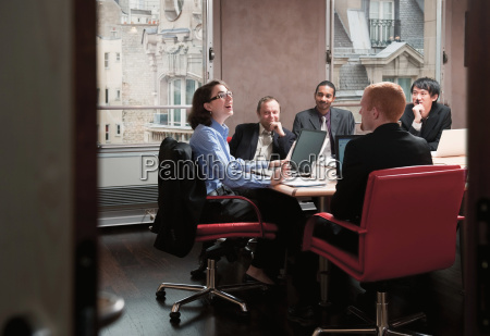 young woman leading business meeting