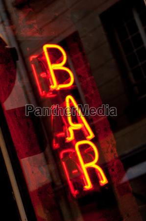 neon bar sign in paris france