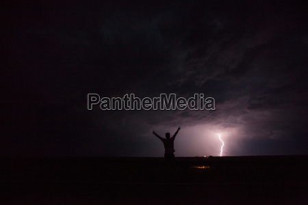 man in thunder storm