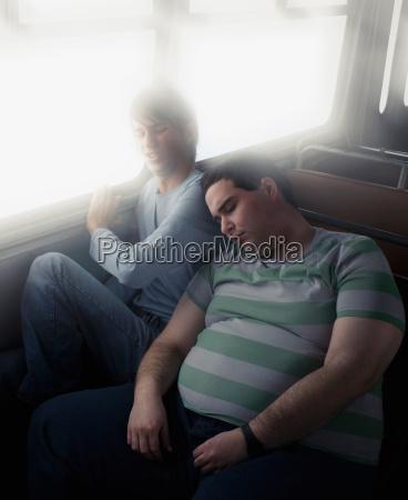 thin boy squashed by fat boy