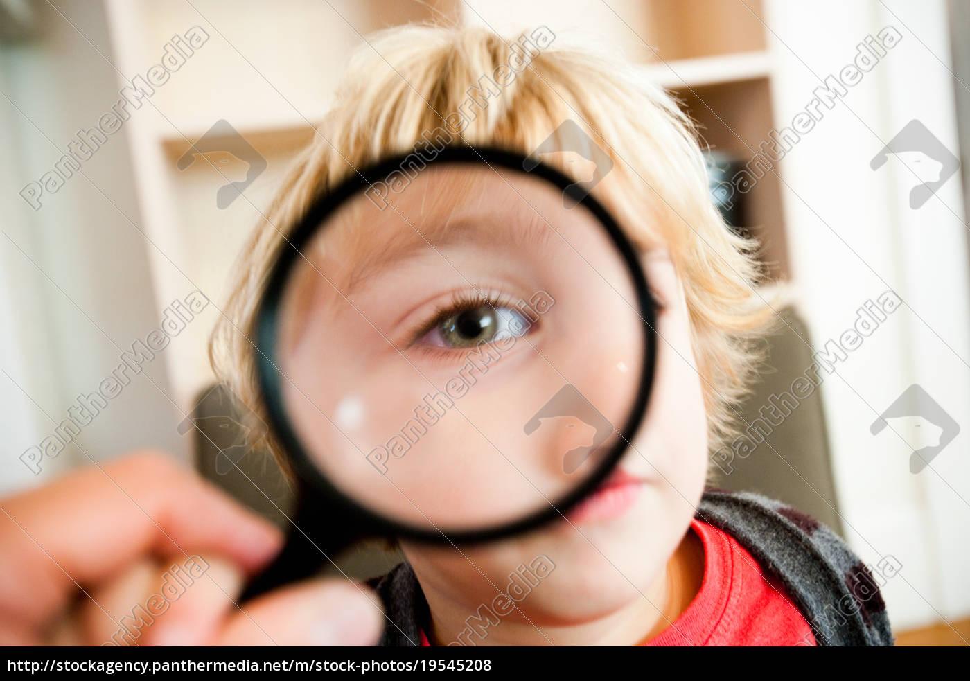 young, boy, looking, at, camera, through - 19545208