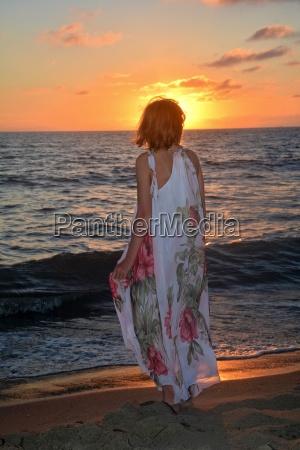 girl in long dress standing on