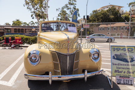 yellow 1940 ford deluxe convertible