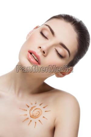 girl with cream sun shape drawing