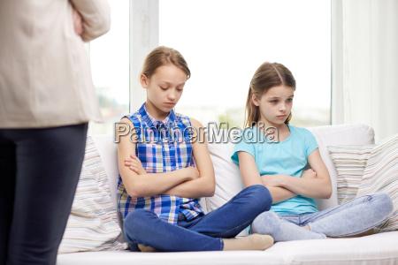 upset guilty little girls sitting on