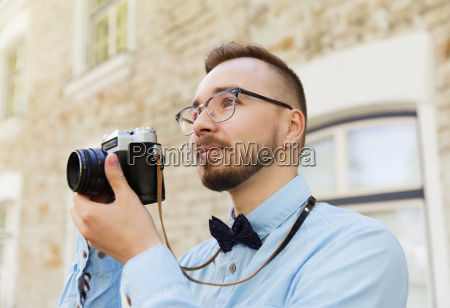 young hipster man with film camera