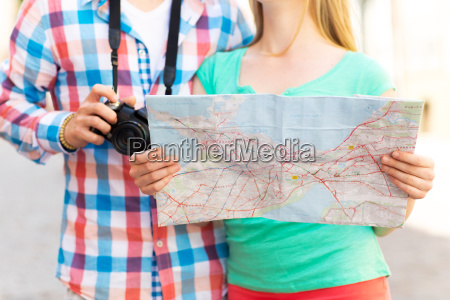 close up of couple with map