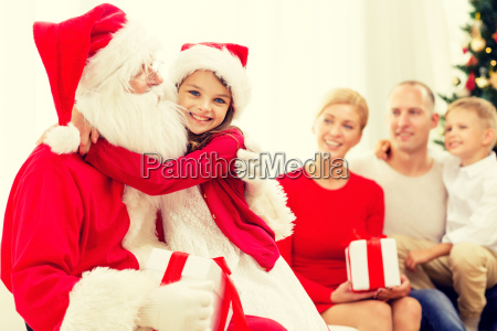 smiling family with santa claus and