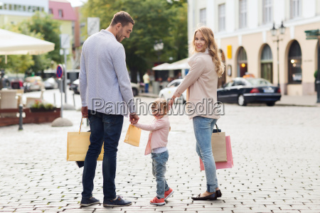 happy family with child and shopping