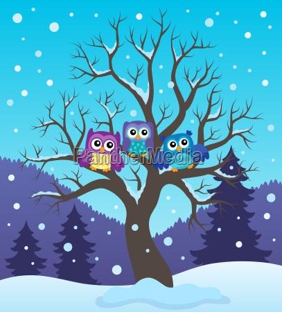 stylized owls on tree theme image
