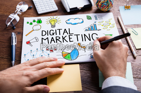 businessperson hand drawing digital marketing diagram
