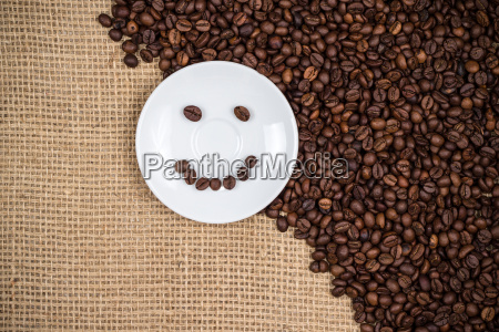 white coffeeplate with smiley coffeebeans