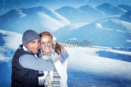 happy couple on winter resort