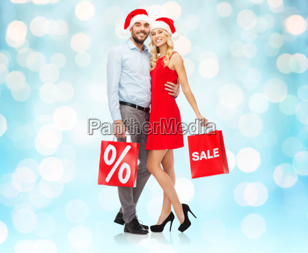 happy couple in santa hats with