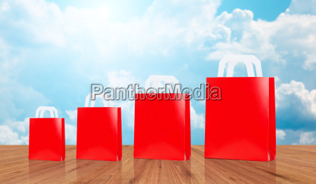 many blank red shopping bags