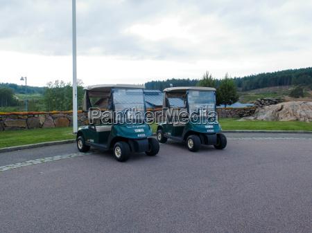 two golf car on hills golf