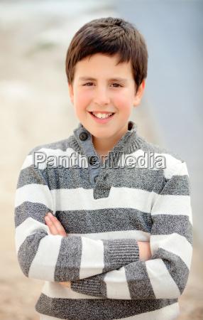 smiling teenage boy of thirteen with