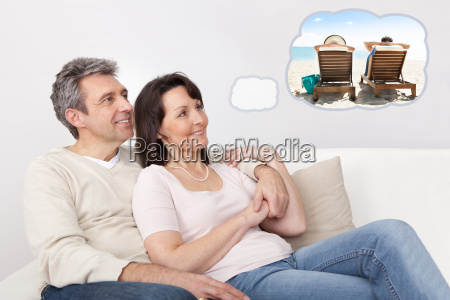 happy mature couple dreaming about the