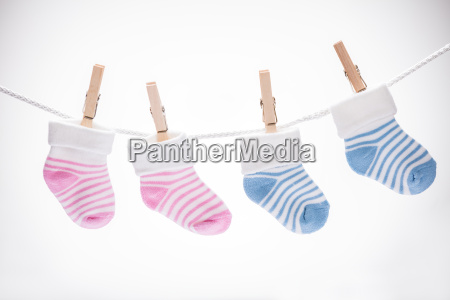 pair of baby sock hanging on