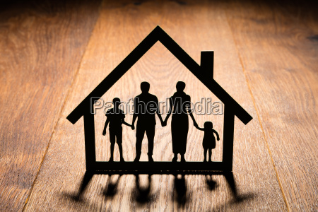 papercut of house with family in