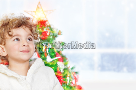 cute little boy near christmas tree