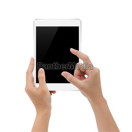 hand using digital tablet on white