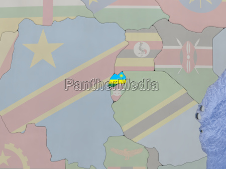 rwanda with flag on globe